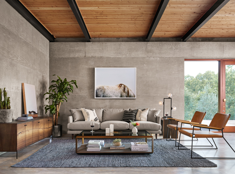 living room featuring coffee table, a stylish storage solution for your home