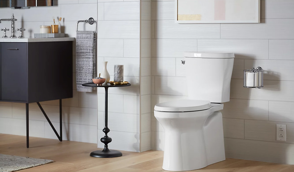 newly remodeled bathroom featuring toilet and floors