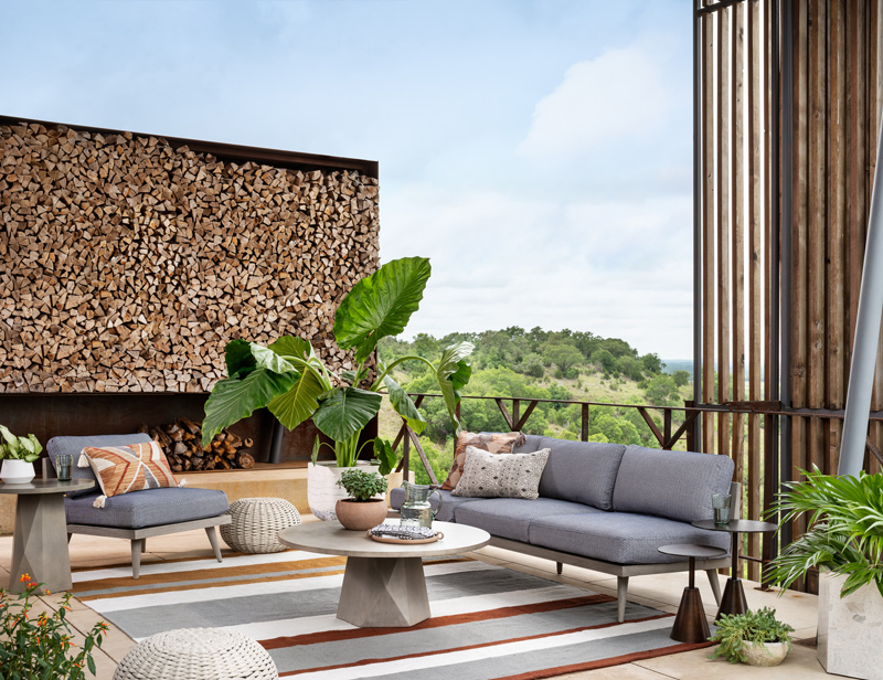 accessorized outdoor living space with neutral furniture colors and accessories