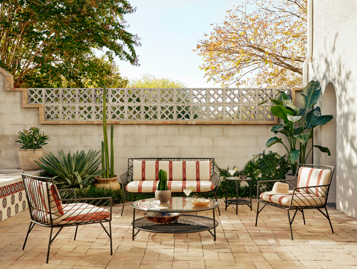 outdoor living space with couches and plants