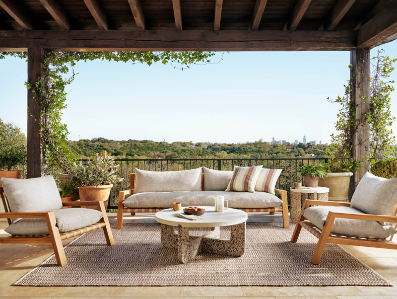 covered outdoor living space with couches and a rug