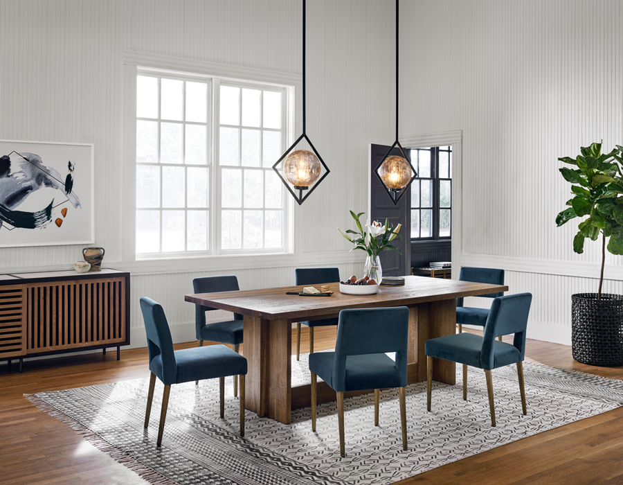 two kitchen pendants hanging over kitchen table