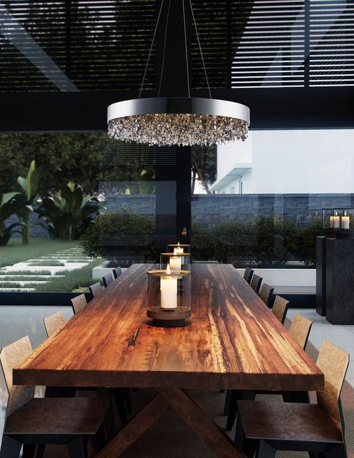 multi-pendant light in kitchen over table at night
